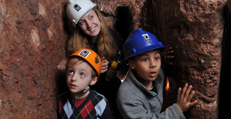 A family on a tour of Exeter's Underground Passages