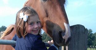 A girl next to a horse
