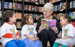 Jacqueline Wilson reads to children from Soho Family Centre to launch the 20th anniversary of World Book Day