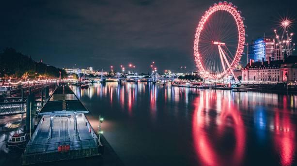 London Eye lit up at night, London, England.