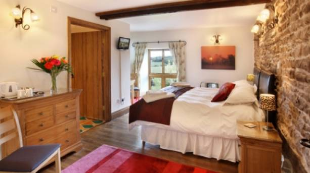 A bedroom in a Trevase Cottage