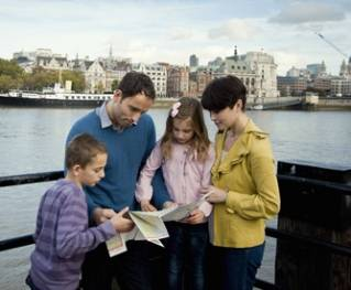 A family studying the map
