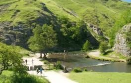 Hop over stepping stones across the River Dove at Dovedale